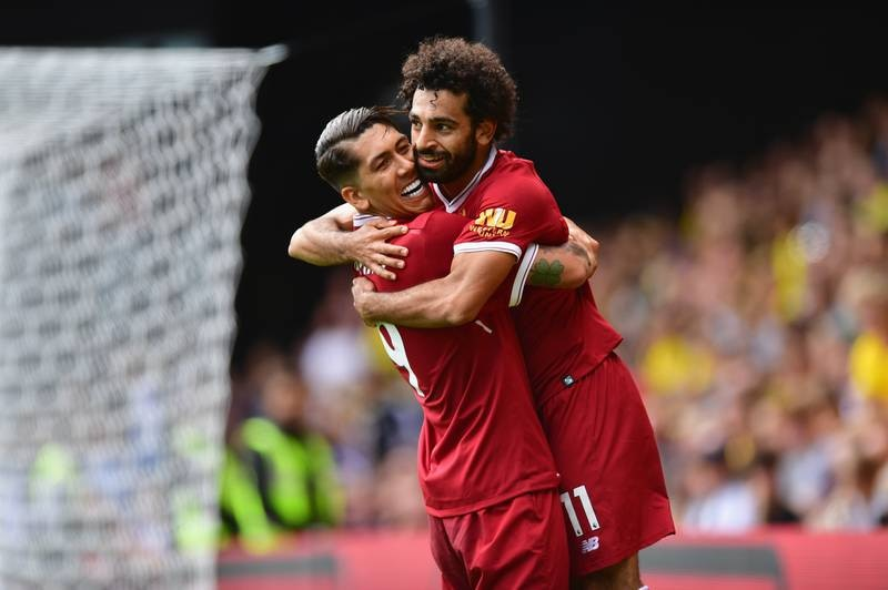 WATFORD, ENGLAND - AUGUST 12:  Mohamed Salah of Liverpool celebrates scoring his sides third goal with Roberto Firmino of Liverpool during the Premier League match between Watford and Liverpool at Vicarage Road on August 12, 2017 in Watford, England.  (Photo by Alex Broadway/Getty Images)