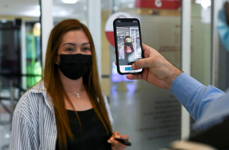 Face Scanning Detection-AD  Instant detection appears on the hand held device with the new EDE scanner at Al Wahda Mall in Abu Dhabi on June 28, 2021. Khushnum Bhandari/ The National Reporter: N/A News