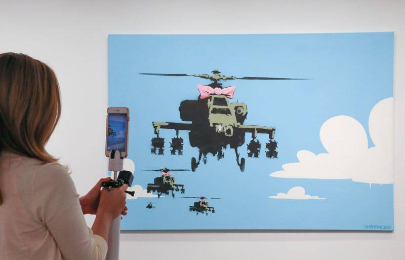 epa07017553 A piece by the street artist Banksy, acquired by actor Robin Williams is among his auction items on display in Los Angeles, California, USA, 12 September 2018  (issued 13 September 2018). The October auction of hundreds of artworks, movie props, toys and sports memorabilia from 'Creating a Stage: The Collection of Marsha and Robin Williams' will take place in New York.  EPA-EFE/EUGENE GARCIA