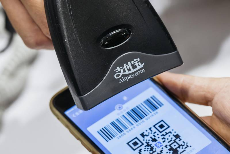 An employee scans a quick response (QR) code displayed on the Ant Financial Services Group's Alipay app, an affiliate of Alibaba Group Holding Ltd., inside a Sa Sa International Holdings Ltd. store in an arranged photograph in Hong Kong, China, on Tuesday, Nov. 1, 2016. The urgency to prepare regulatory environments for fintech is growing as banks begin offering digital services such as biometric authentication and as mobile-payment systems such as Apple Pay and AliPay are introduced around the region. Photographer: Anthony Kwan/Bloomberg