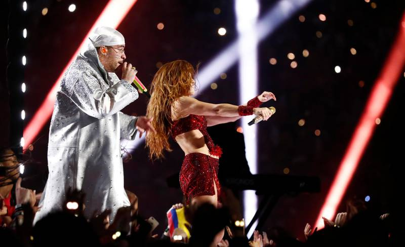 epa08189430 Colombian singer Shakira (R) and Puerto Ricans singer Bad Bunny (L) performs during halftime of the National Football League's Super Bowl LIV at Hard Rock Stadium in Miami Gardens, Florida, USA, 02 February 2020.  EPA-EFE/LARRY W. SMITH
