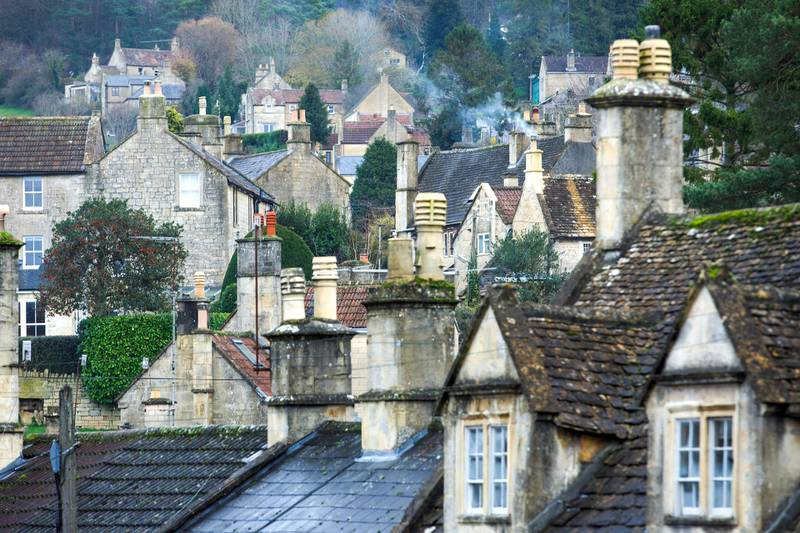 Smoke rises from chimneys in the village of Box, U.K., on Wednesday, Dec. 9, 2020. Jonathan Baylis, founder of LogsNearMe.co.uk, had a hunch that firewood was a Covid-proof business. Photographer: Luke MacGregor/Bloomberg via Getty Images