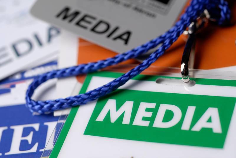 Stock Photo of media passes.