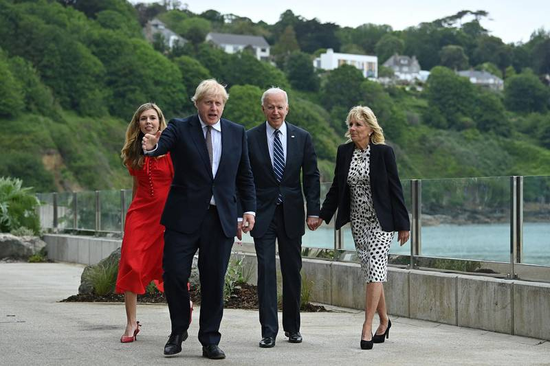 Britain's Prime Minister Boris Johnson (2L) and Britain's First Lady Carrie Johnson (L) walk with US President Joe Biden and US First Lady Jill Biden prior to a bi-lateral meeting at Carbis Bay, Cornwall on June 10, 2021, ahead of the three-day G7 summit being held from 11-13 June.  G7 leaders from Canada, France, Germany, Italy, Japan, the UK and the United States meet this weekend for the first time in nearly two years, for the three-day talks in Carbis Bay, Cornwall. -   / AFP / Brendan SMIALOWSKI