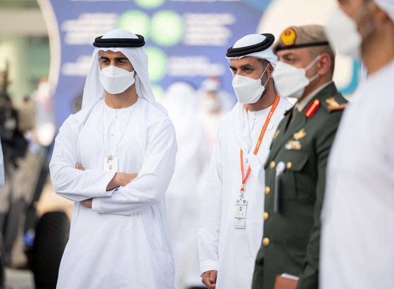 ABU DHABI, UNITED ARAB EMIRATES - February 23, 2021: HH Sheikh Hamdan bin Mohamed bin Zayed Al Nahyan (L) and HH Sheikh Mohamed bin Hamad bin Tahnoon Al Nahyan (2nd L), tour the International Defence Exhibition and Conference 2021 (IDEX), at ADNEC.  ( Rashed Al Mansoori / Ministry of Presidential Affairs ) ---