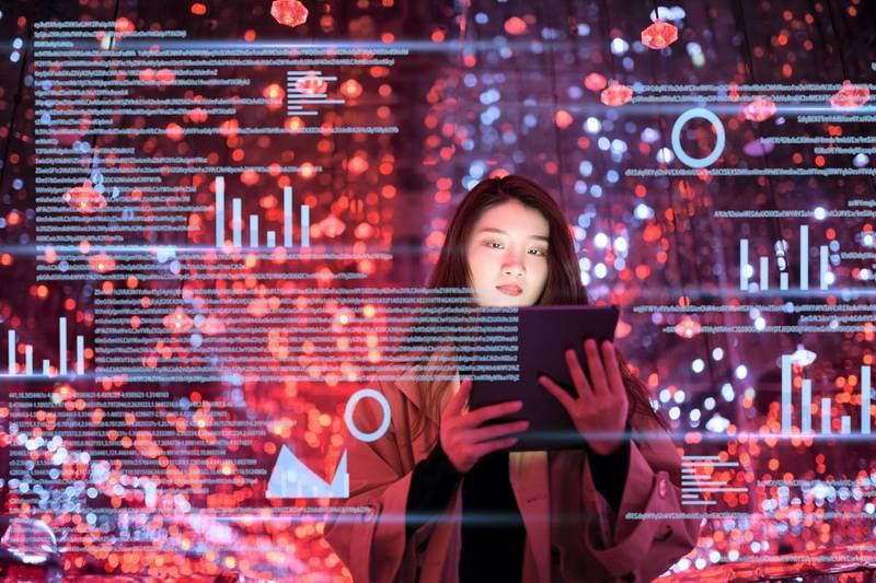 young asian woman uses digital tablet on virtual visual screen at night