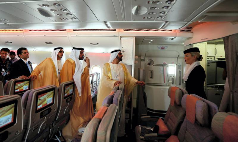Ruler of Dubai Sheikh Mohammed Bin Rashid al-Maktoum (C), takes a tour of the Emirates A380 airliner, during the opening ceremony of the Dubai Airshow on November 17, 2013. AFP PHOTO/MARWAN NAAMANI (Photo by MARWAN NAAMANI / AFP)