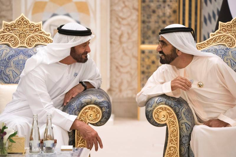 ABU DHABI, UNITED ARAB EMIRATES - May 20, 2018: HH Sheikh Mohamed bin Zayed Al Nahyan Crown Prince of Abu Dhabi Deputy Supreme Commander of the UAE Armed Forces (L), speaks with HH Sheikh Mohamed bin Rashid Al Maktoum, Vice-President, Prime Minister of the UAE, Ruler of Dubai and Minister of Defence (R), during an iftar reception at the Presidential Palace.   ( Hamad Al Kaabi / Crown Prince Court - Abu Dhabi ) ---