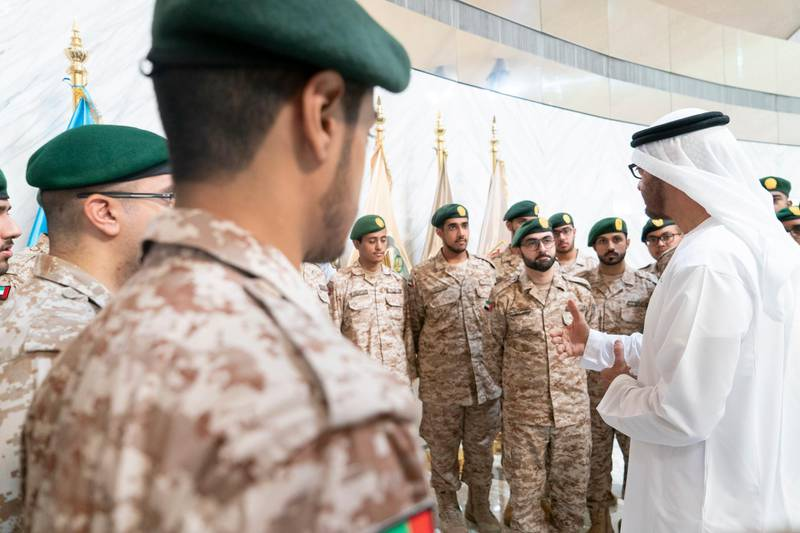 ABU DHABI, UNITED ARAB EMIRATES - April 28, 2019: HH Sheikh Mohamed bin Zayed Al Nahyan, Crown Prince of Abu Dhabi and Deputy Supreme Commander of the UAE Armed Forces (R), speaks with national service recruits during the e-skills exhibition for national service recruits, at Armed Forces Officers Club. ( Rashed Al Mansoori / Ministry of Presidential Affairs ) ---