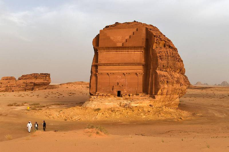 A picture taken on March 31, 2018 shows a Saudi man standing at the entrance of a tomb at Madain Saleh, a UNESCO World Heritage site, near Saudi Arabia's northwestern town of al-Ula. - Al-Ula, an area rich in archaeological remnants, is seen as a jewel in the crown of future Saudi attractions as the austere kingdom prepares to issue tourist visas for the first time -- opening up one of the last frontiers of global tourism. Saudi Crown Prince Mohammed bin Salman is set to sign a landmark agreement with Paris on April 10, 2018 for the touristic and cultural development of the northwestern site, once a crossroads of ancient civilisations. (Photo by FAYEZ NURELDINE / AFP)