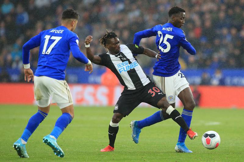 Newcastle United's Ghanaian midfielder Christian Atsu (C) vies with Leicester City's Spanish striker Ayoze Perez (L) and Leicester City's Nigerian midfielder Wilfred Ndidi (R) during the English Premier League football match between Leicester City and Newcastle United at King Power Stadium in Leicester, central England on September 29, 2019. - Leicester won the game 5-0. (Photo by Lindsey Parnaby / AFP) / RESTRICTED TO EDITORIAL USE. No use with unauthorized audio, video, data, fixture lists, club/league logos or 'live' services. Online in-match use limited to 120 images. An additional 40 images may be used in extra time. No video emulation. Social media in-match use limited to 120 images. An additional 40 images may be used in extra time. No use in betting publications, games or single club/league/player publications. /