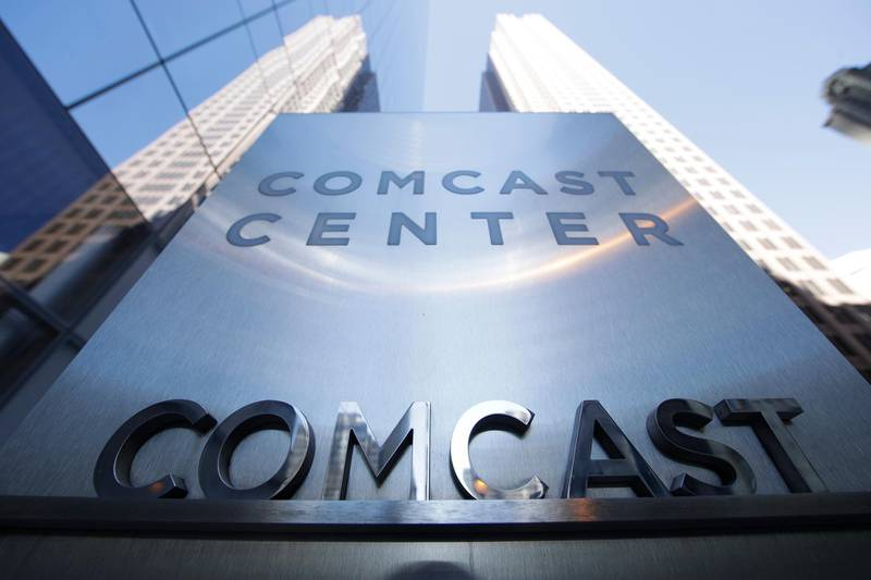FILE- This March 29, 2017, file photo shows a sign outside the Comcast Center in Philadelphia. Comcast Corp. reports earnings Wednesday, April 25, 2018. (AP Photo/Matt Rourke, File)