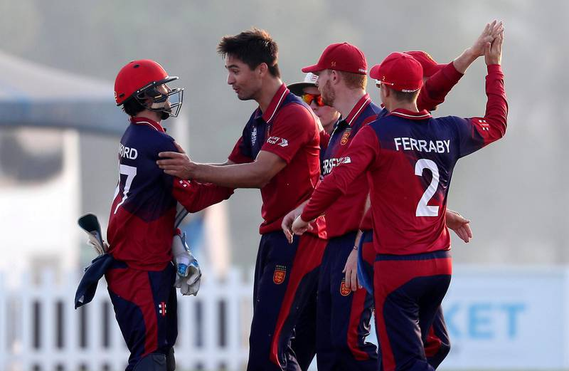 ABU DHABI , UNITED ARAB EMIRATES , October 22  – 2019 :- Ben Stevens (center) of Jersey celebrating after taking the wicket of Rameez Shahzad during the World Cup T20 Qualifiers between UAE vs Jersey held at Tolerance Oval cricket ground in Abu Dhabi.  ( Pawan Singh / The National )  For Sports. Story by Paul