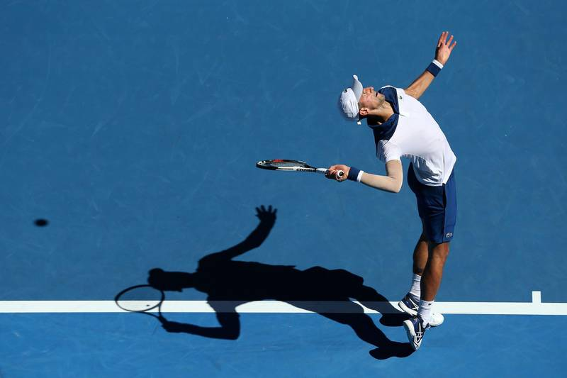MELBOURNE, AUSTRALIA - JANUARY 16:  Novak Djokovic of Serbia serves in his first round match against Donald Young of the United States on day two of the 2018 Australian Open at Melbourne Park on January 16, 2018 in Melbourne, Australia.  (Photo by Michael Dodge/Getty Images)