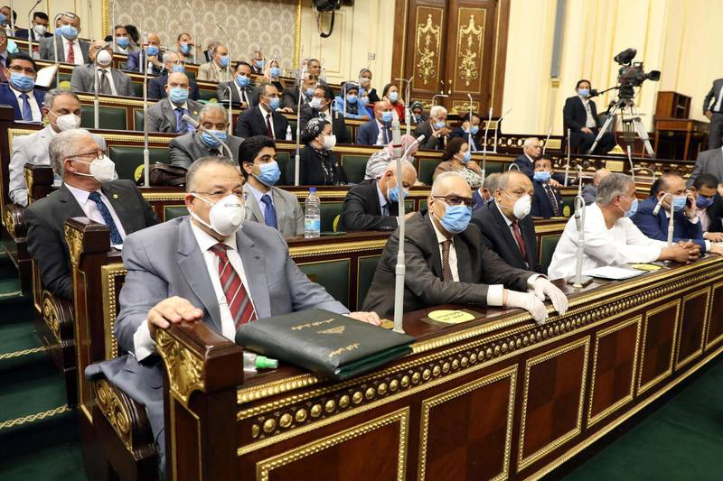 Egyptian parliament members attend a general session in the capital Cairo on July 20, 2020.      Egypt's parliament greenlighted today the possible deployment of troops in Libya to support Cairo's ally Khalifa Haftar, if rival Turkish-backed forces recapture the city of Sirte, the house said. / AFP / -