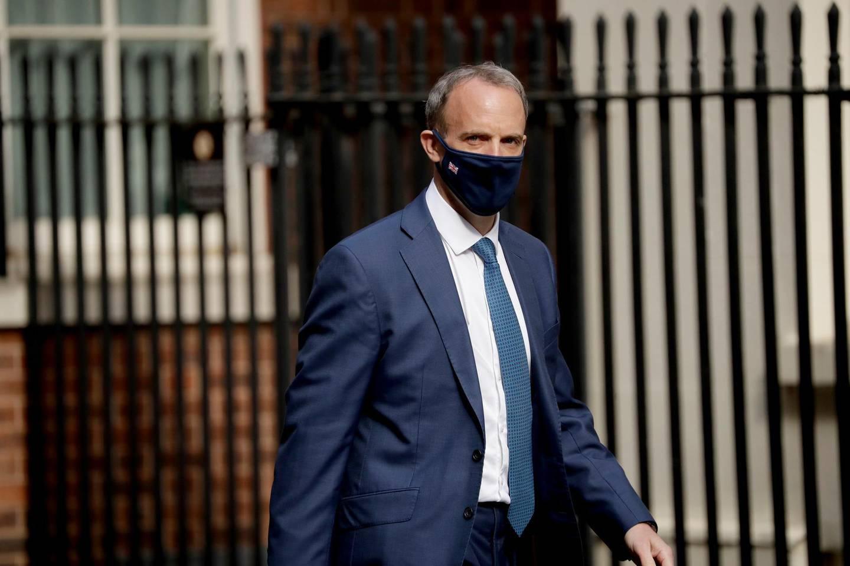 Britain's Foreign Secretary Dominic Raab walks into Downing Street in London, Tuesday, April 27, 2021. (AP Photo/Matt Dunham)