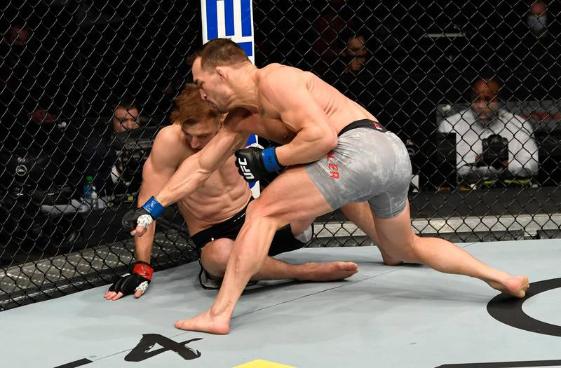 ABU DHABI, UNITED ARAB EMIRATES - JANUARY 23: (R-L) Michael Chandler punches Dan Hooker of New Zealand in a lightweight fight during the UFC 257 event inside Etihad Arena on UFC Fight Island on January 23, 2021 in Abu Dhabi, United Arab Emirates. (Photo by Jeff Bottari/Zuffa LLC)