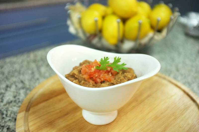 Ful medames or foule mudammes is an Egyptian dish of cooked fava beans served with vegetable oil, cumin, and optionally with chopped parsley, garlic, onion, lemon juice, and chili pepper. Cooked by Fatima Al Marzooqi.    Fatima Al Marzooqi / The National *** Local Caption ***  FM_Foul2016_006.JPG