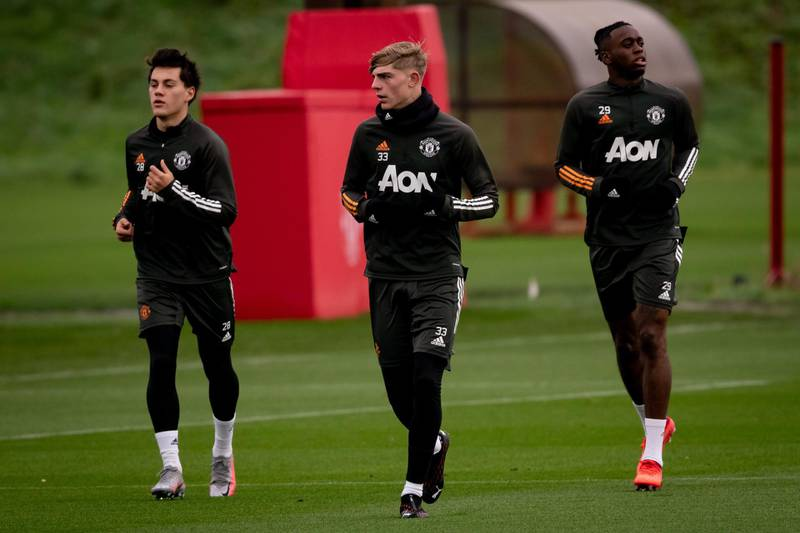 MANCHESTER, ENGLAND - NOVEMBER 16: (EXCLUSIVE COVERAGE) Facundo Pellistri, Brandon Williams, Aaron Wan-Bissaka of Manchester United in action during a first team training session at Aon Training Complex on November 16, 2020 in Manchester, England. (Photo by Ash Donelon/Manchester United via Getty Images)