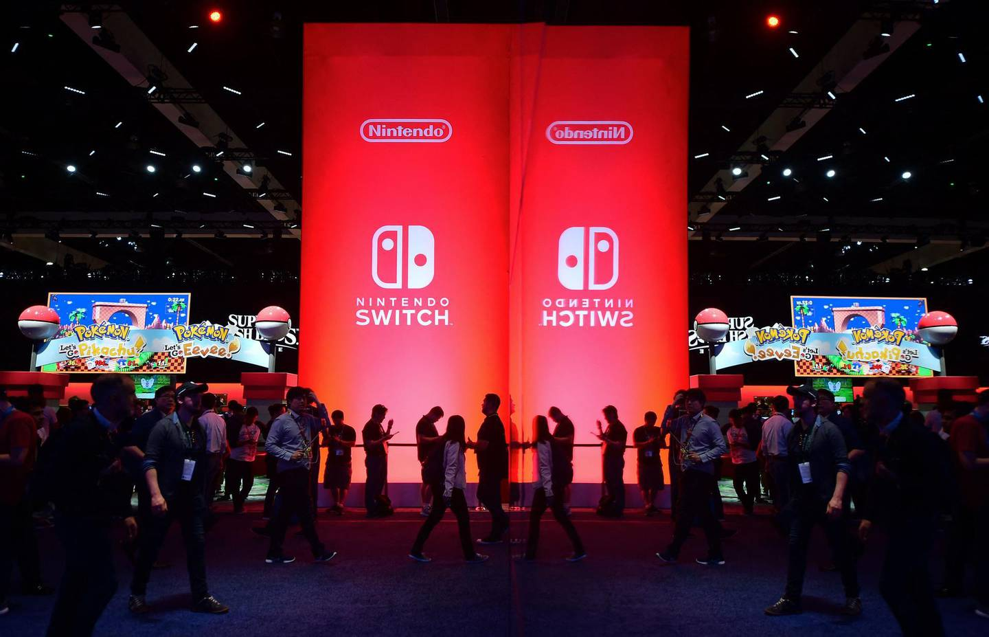 (FILES) In this file photo taken on June 12, 2018, people wait line to sample Nintendo Switch games at the 24th Electronic Expo, or E3 2018, in Los Angeles. Nintendo on June 15, 2021, unveiled updated versions of its hit console games including Zelda and Super Smash Brothers, but disappointed fans looking for a new model of its popular Switch console. / AFP / Frederic J. BROWN