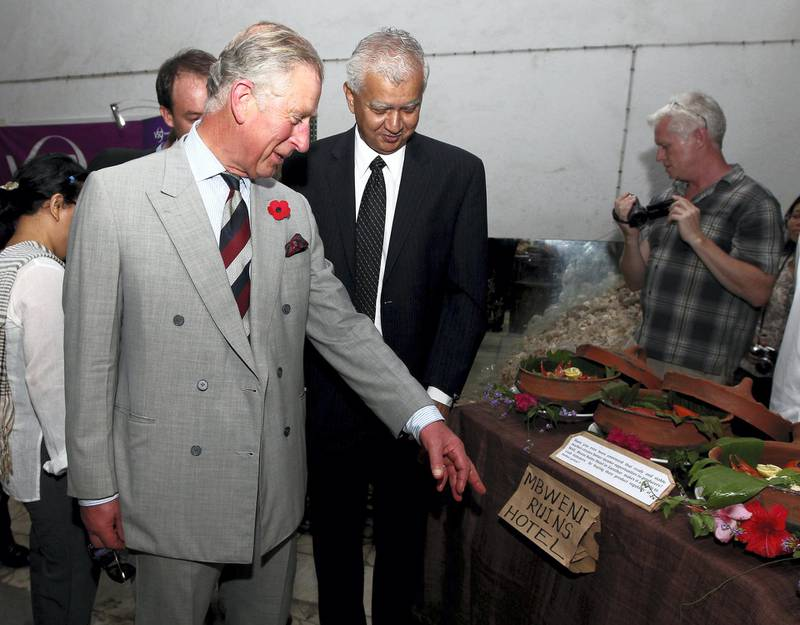 ZANZIBAR, TANZANIA - NOVEMBER 08:  Prince Charles, Prince of Wales views displays during a visit to the House of Wonders on November 8, 2011 in Zanzibar, Tanzania. The Prince of Wales and Camilla, Duchess of Cornwall are on a four day tour of Tanzania after a successful trip to South Africa. The Royal couple will be highlighting environmental and social issues during their visit to Africa.  (Photo by Gareth Fuller - Pool/Getty Images)