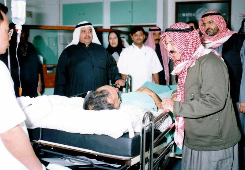 Kuwaiti's first deputy premier, foreign minister and chairman of the Supreme Petroleum Council sheikh Sabah al-Ahmad al-Sabah visits injured oil workers following a blast at the al-Rawdhatain oilfield north of Kuwait, near the border with Iraq. Four people were killed and 19 others injured.      AFP PHOTO/Yasser AL-ZAYYAT (Photo by YASSER AL-ZAYYAT / AFP)