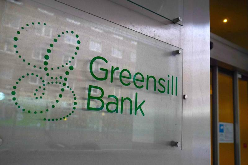 """(FILES) This file photo taken on March 15, 2021 shows the logo of the Greensill bank at its headquarters in Bremen, northern Germany. Insolvency proceedings have been launched for Germany's Greensill Bank a week after the collapse of its British owner, financial services firm Greensill, a court said on March 16, 2021. The proceedings began for Bremen-based Greensill Bank """"at the request of (financial regulator) Bafin"""", the court in Bremen said in a statement. Bafin had ordered a freeze on the bank's activities in early March because of a risk that its debt would become unmanageable.  / AFP / Patrik Stollarz"""