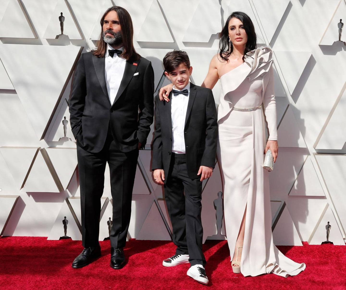 epa07394181 Khaled Mouzanar (L) Zain al-Rafeea (C) and Nadine Labaki (R) arrive for the 91st annual Academy Awards ceremony at the Dolby Theatre in Hollywood, California, USA, 24 February 2019. The Oscars are presented for outstanding individual or collective efforts in 24 categories in filmmaking.  EPA-EFE/ETIENNE LAURENT