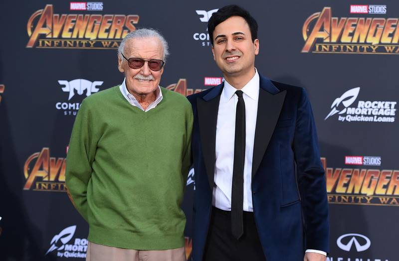 """FILE - In this April 23, 2018 file photo, Stan Lee, left, and Keya Morgan arrive at the world premiere of """"Avengers: Infinity War"""" in Los Angeles. Lee has taken out a restraining order against Morgan who had been acting as his business manager and close adviser. Lee took out the order Wednesday, two days after Morgan was arrested on suspicion of filing a false police report. (Photo by Jordan Strauss/Invision/AP, File)"""