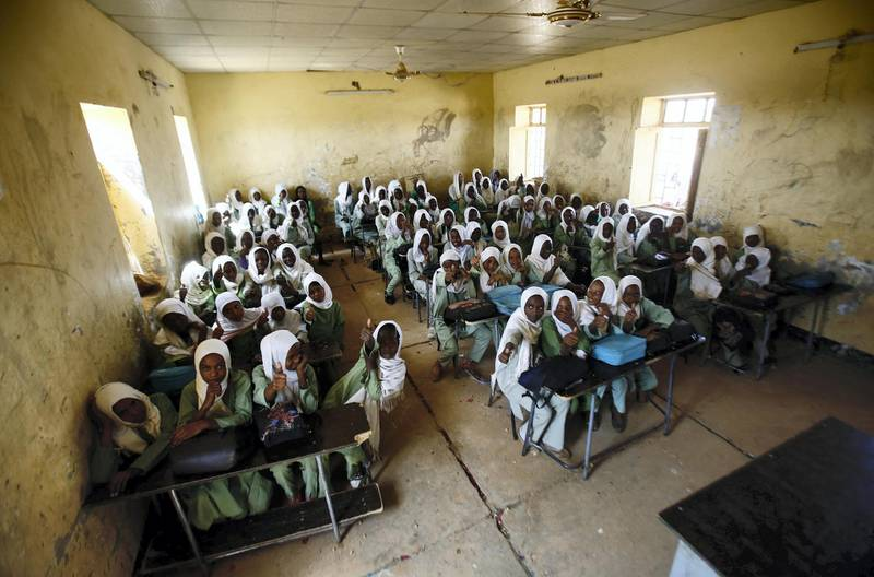 Sudanese girls sit in a classroom at the El-Riyadh camp for internally displaced persons (IDP) in Geneina, the capital of the state of Sudan's West Darfur, on February 8, 2017. (Photo by ASHRAF SHAZLY / AFP)