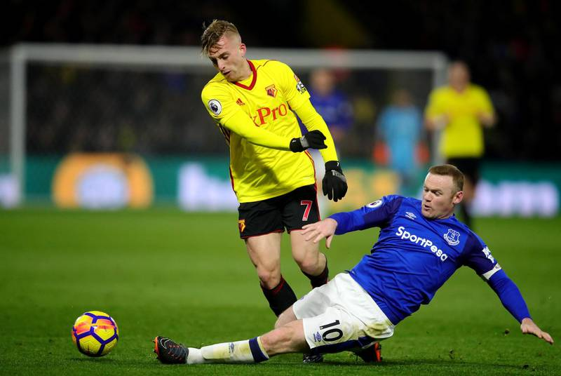 WATFORD, ENGLAND - FEBRUARY 24:  Wayne Rooney of Everton tackles Gerard Deulofeu of Watford during the Premier League match between Watford and Everton at Vicarage Road on February 24, 2018 in Watford, England.  (Photo by Chris Brunskill/Getty Images)