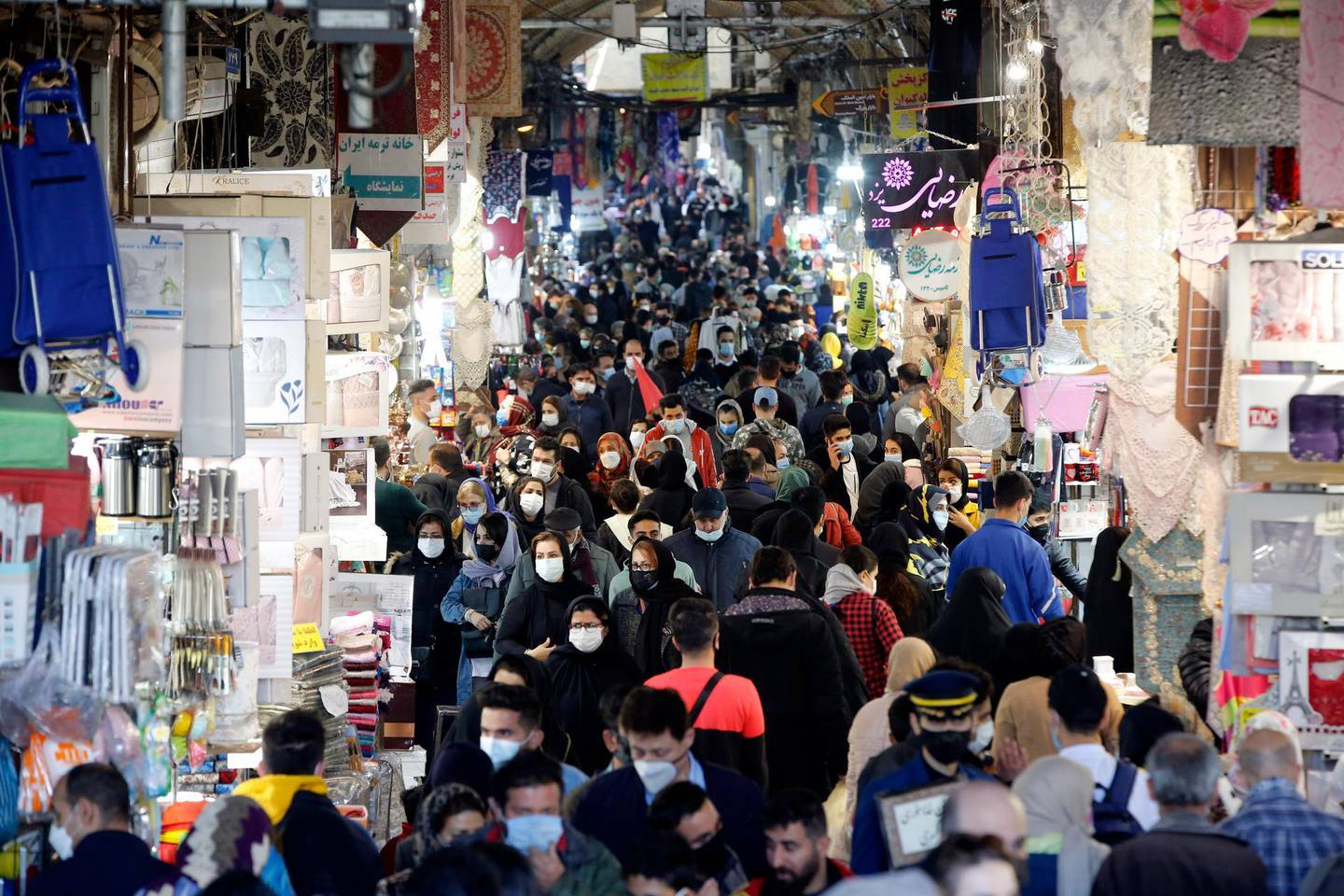 epa09045996 Iranians wearing face masks go shopping in old grand bazaar in Tehran, Iran, 02 March 2021. According to Iranian foreign ministry Iran has rejected an offer by the European Union to engage in direct talks with the United States over the 2015 nuclear deal, saying that US should lift sanctions before any kind of talks. Iran is struggling with hard economic crisis over though sanctions by US administrations as the tensions between Iran and US is going on over Iran's dispute nuclear program.  EPA/ABEDIN TAHERKENAREH
