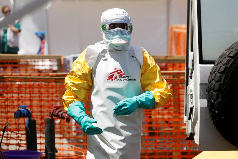 A health worker dressed in protective suit disinfects an ambulance transporting a suspected Ebola patient to the newly constructed MSF (Doctors Without Borders) Ebola treatment centre in Goma, Democratic Republic of Congo, August 4, 2019.REUTERS/Baz Ratner