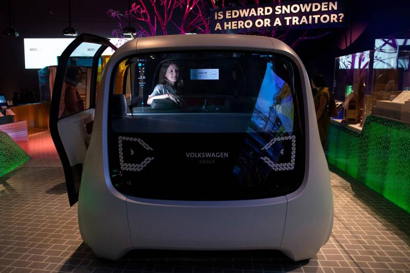 epa06721942 A member of the public looks from the inside of a Sedric' Volkswagen driverless concept car during a media preview of 'The Future Starts Here' Exhibition at the Victoria and Albert (V&A) Museum in central London, Britain, 09 May 2018. The exhibition features over 100 objects currently in development intended to bring further automation to the everyday tasks.  EPA/WILL OLIVER