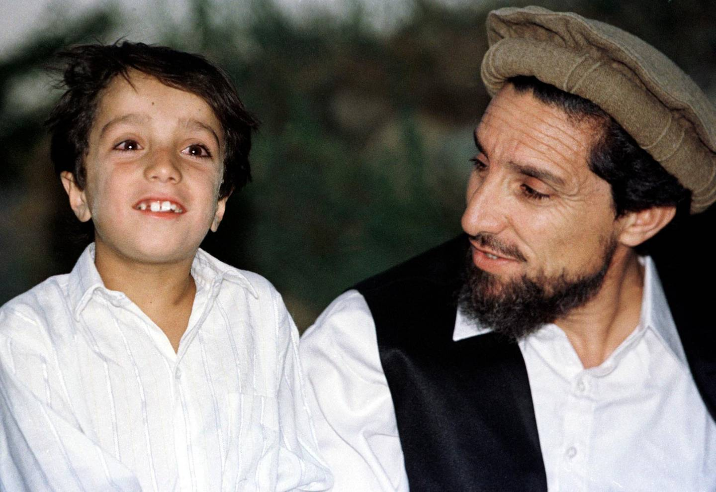 (FILES) In this file photo taken on August 21, 1997 Afghan Commander Ahmad Shah Massoud shares a private moment with his eight-year old son Ahmed, on August 21, 1997, in his house in the Panjshir Valley.  / AFP / Emmanuel DUNAND