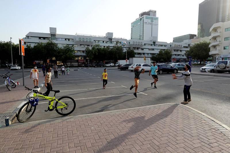 Dubai, United Arab Emirates - Reporter: N/A. Street Photography. Children play football in Al Karama. Sunday, April 18th, 2021. Dubai. Chris Whiteoak / The National
