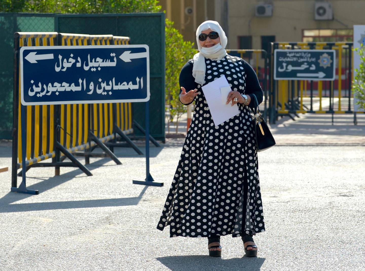 epa08774913 Noura al-Mulaifi, arrives to file candidacy papers for the upcoming parliamentary elections, at elections registration center in Kuwait City, Kuwait, 26 October 2020. Parliamentary elections in Kuwait are scheduled for 05 December.  EPA/NOUFAL IBRAHIM