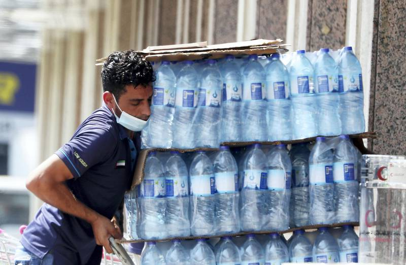 DUBAI, UNITED ARAB EMIRATES , October 3 – 2020 :- A worker wearing protective face mask as a preventive measure against the spread of coronavirus in Al Karama area in Dubai. (Pawan Singh / The National) For News/Stock/Online.