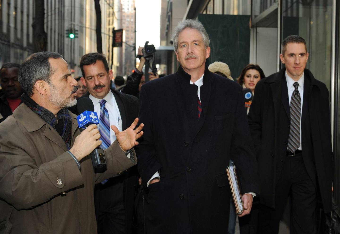 (FILES) In this file photograph taken on January 16, 2010, a reporter from Iranian television (L) asks a question of US diplomat Williams Burns (C) as he leaves a meeting of the 'Iran 6' in New York. As six major powers huddled behind closed doors to mull a response to Iran's nuclear defiance.   US President-elect Joe Biden on January 11, 2021, has announced William Burns as his pick to lead the Central Intelligence Agency, tapping a veteran diplomat who has served in posts around the world. / AFP / Don EMMERT