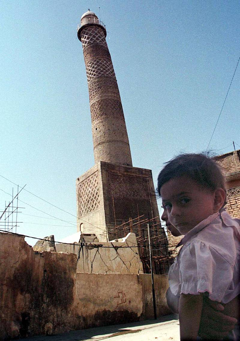FILE - This Sept. 25, 1998 file photo shows the tilting al-Hadba minaret in Mosul, Iraq. Iraq's ministry of defense says IS destroyed the al-Nuri mosque in Mosul and the adjacent iconic leaning minaret when fighters detonated explosives inside the structures late Wednesday night on June 21, 2017. (AP Photo/Jassim Mohammed, File)