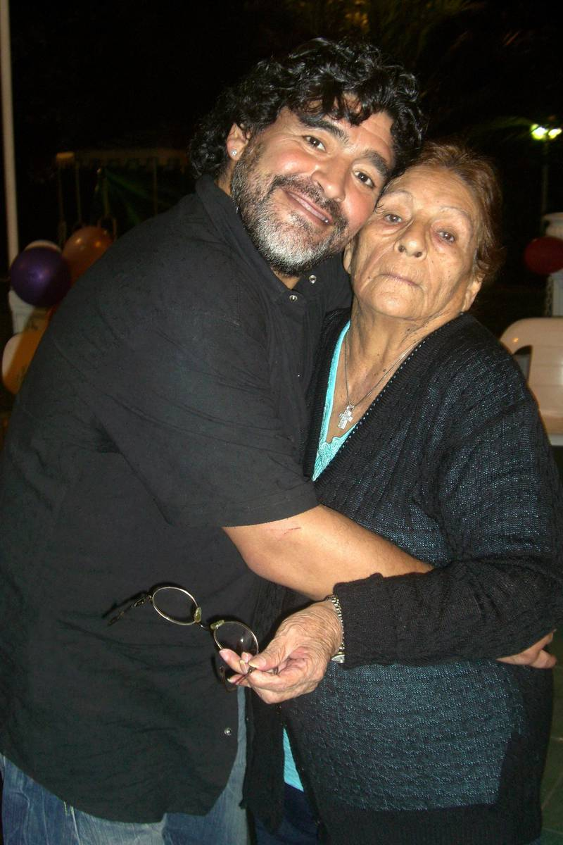 Handout picture given by Maradona's family showing Argentine former soccer star and coach of United Arab Emirates club Al-Wasl, Diego Maradona with his mother Dalma on September 2011 in Buenos Aires, in what it is supposed to be the last picture with her son Diego, according with Maradona's family.  Dalma Franco de Maradona, known to Argentines as Dona Tota, died late Saturday in a Buenos Aires clinic where was being treated for a heart condition. AFP PHOTO/MARADONA FAMILY/HO                               RESTRICTED TO EDITORIAL USE-NO MARKETING NO ADVERTISING CAMPAIGNS-MANDATORY CREDIT AFP PHOTO/MARADONA FAMILY/HO  -DISTRIBUTED AS A SERVICE TO CLIENTS (Photo by HO / AFP)