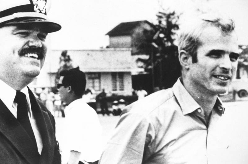 P368426 02: (File Photo) U.S. Navy Lt. Cmdr. Jay Coupe, Left, Escorts Lt. Cmdr. John Mccain To A Waiting U.S. Air Force C-141A Starlifter Cargo Transport Aircraft At Gia Lam Airport March 14, 1973 In Hanoi, North Vietnam. Senator Mccain Had Just Been Released From A North Vietnamese Prison Camp.  (Photo By Getty Images)