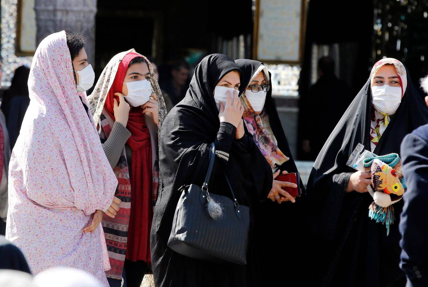 epa08233804 Iranian women wearing face masks wait in line at a polling station set up at the Abdol Azim shrine during the parliamentary elections in Shahr-e-Ray, Tehran Province, Iran, 21 February 2020. Iranians are heading to the polls to elect their representatives to the Islamic Consultative Assembly amid a worsening economic crisis and escalating tensions with the US.  EPA/ABEDIN TAHERKENAREH