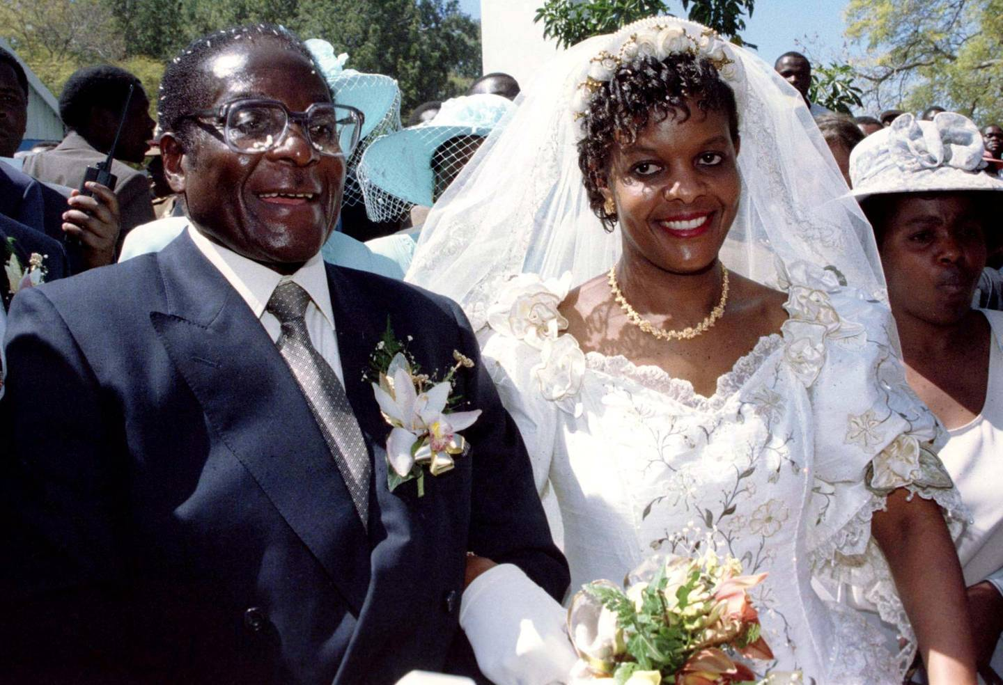 FILE PHOTO: President Robert Mugabe and new wife Grace leave the Kutama Catholic Church in Zimbabwe August 17, 1996 after exchanging their wedding vows. REUTERS/Howard Burditt/File Photo