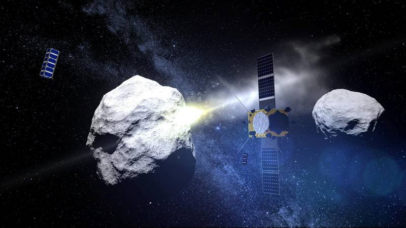 """This computer generated handout image released by the European Space Agency (ESA) on May 15, 2015 shows the impact of the DART (Double Asteroid Redirection Test) projectile on the binary asteroid system (65803) Didymos observed by the AIM (Asteroid Impact Mission) satellite. - The Asteroid Impact Mission (AIM) is a European Space Agency's mission, scheduled to be launched in 2020. AIM will travel to a binary asteroid system – the paired Didymos asteroids, which will come a comparatively close 11 million km to Earth in 2022. For a successful joint mission, one spacecraft, DART would impact the secondary of the Didymos binary system in October 2022 while AIM would first characterize the target asteroid (surface and internal properties), observe the impact event and measure any change in the relative orbit. (Photo by Handout / EUROPEAN SPACE AGENCY / AFP) / RESTRICTED TO EDITORIAL USE - MANDATORY CREDIT """"AFP PHOTO / EUROPEAN SPACE AGENCY """" - NO MARKETING NO ADVERTISING CAMPAIGNS - DISTRIBUTED AS A SERVICE TO CLIENTS"""