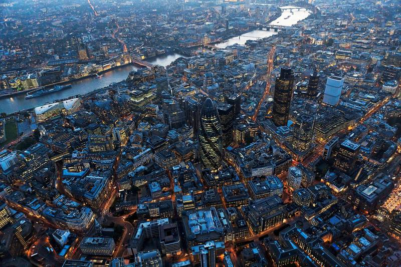 Aerial view of City of London over River Thames at night, London. (Photo by Cityscape Digital/Construction Photography/Avalon/Getty Images)