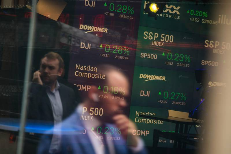 Monitors display stock market information as pedestrians are reflected in a window at the Nasdaq MarketSite in the Times Square area of New York, U.S., on Friday, Sept. 6, 2019. U.S. stocks advanced and Treasuries were mixed as Federal Reserve Chairman Jerome Powell's latest comments did little to alter views on Federal Reserve policy. Photographer: Michael Nagle/Bloomberg
