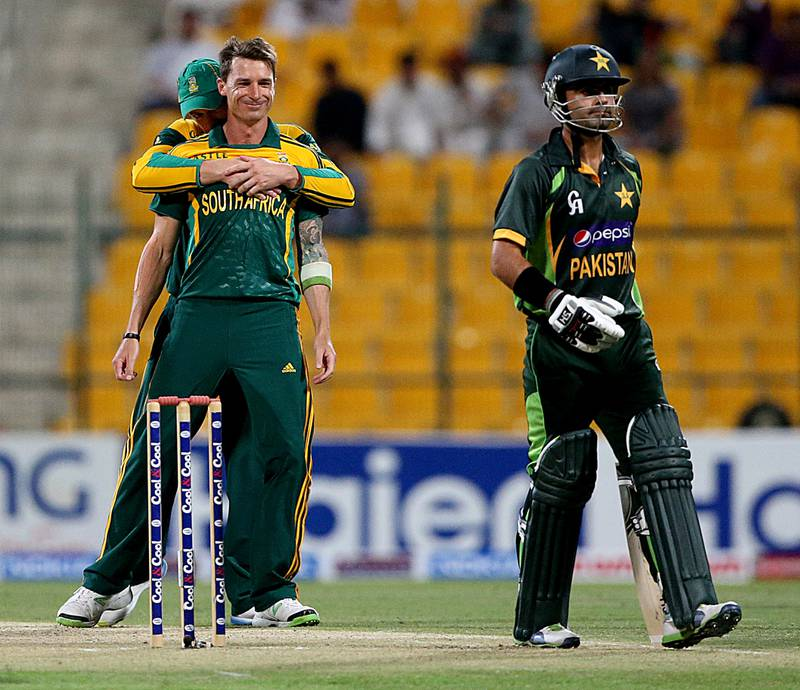 AbuDhabi, United Arab Emirates- November,06, 2013 : (L) Dale Steyn of SouthAfrica  Celebrates after dismissing Ahmed Shahzad of Pakistan (R)  during the 3rd ODI  against Pakistan at the Zayed Stadium in Abudhabi. ( Satish Kumar / The National ) For Sports *** Local Caption ***  SK-Cric-6112013-013.jpg