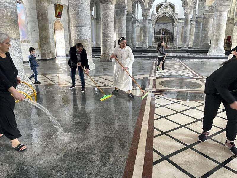 Al Tahira church being cleaned ahead of the Pope's visit. Courtesy Sangar Khaleel