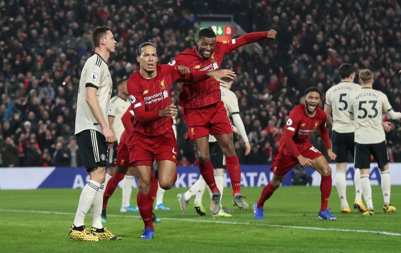 """Soccer Football - Premier League - Liverpool v Manchester United - Anfield, Liverpool, Britain - January 19, 2020   Liverpool's Virgil van Dijk celebrates scoring their first goal with Georginio Wijnaldum   Action Images via Reuters/Carl Recine    EDITORIAL USE ONLY. No use with unauthorized audio, video, data, fixture lists, club/league logos or """"live"""" services. Online in-match use limited to 75 images, no video emulation. No use in betting, games or single club/league/player publications.  Please contact your account representative for further details."""